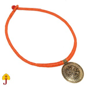 Patwa necklace with metal pendant.