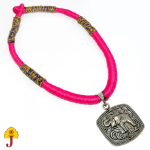 Designer Patwa necklace with metal pendant.