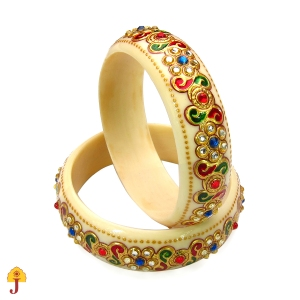 Bangles have acquired a cultural, social and religious significance over centuries. These lightweight design bangles adorns pure traditional-ethnic look. This embellished traditional bangle set,with its pretty red green stones and gold leaf work is truly ravishing.