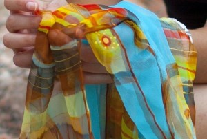 Women artisans engaged in making hand-painted silk scarves